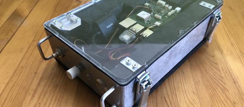 Enviro Bike kit - metalic box with clear lid showing electronic hardware inside